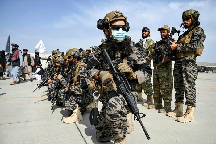 Taliban special forces stand guard at Kabul airport after the departure of US troops