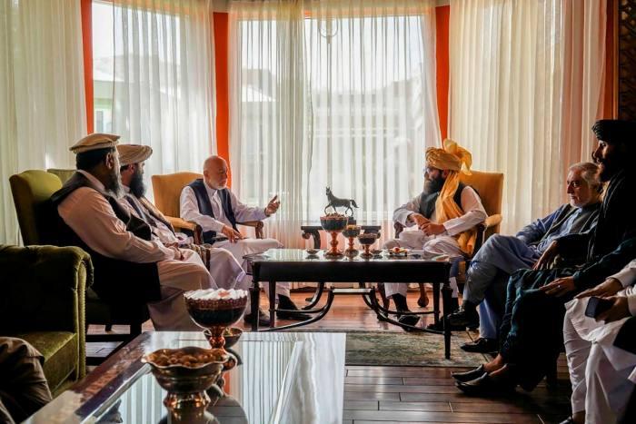 Former Afghan president Hamid Karzai and senior Haqqani group leader Anas Haqqani during a meeting in Kabul on August 18