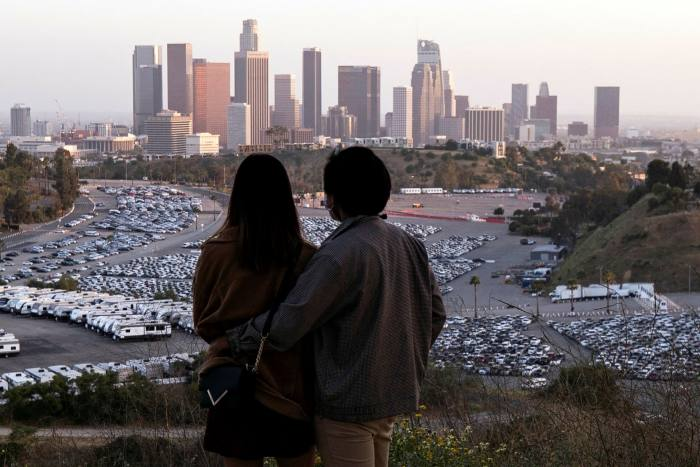 People watch the sunset from Elysian Park in Los Angeles amid the coronavirus pandemic, which has brought large parts of the global economy to a standstill