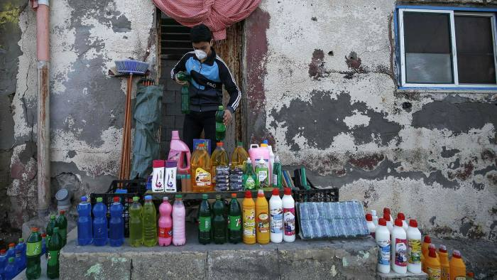 Cleaning tools and disinfectants for sale at the Palestinian al-Shati refugee camp