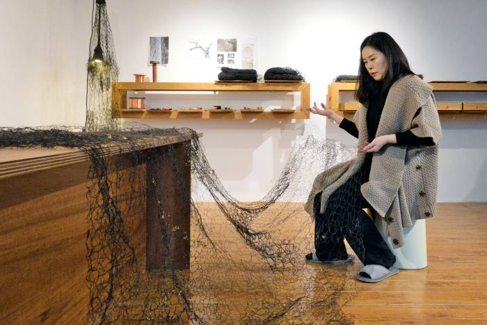 Kyeok Kim inspecting Second Surface at her showroom and studio