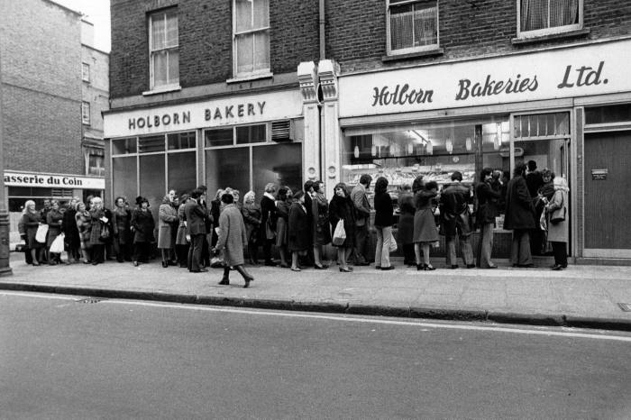 People queue for bread in Holborn, London, during an industrial dispute circa 1974