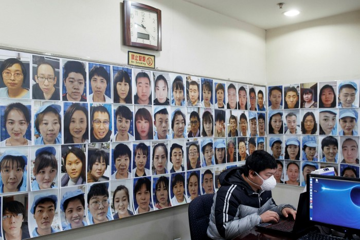 A software engineer works on a facial recognition program in Beijing. The technology used in 'smart cities', which automate multiple municipal functions, represent a big prize for China's standards drive