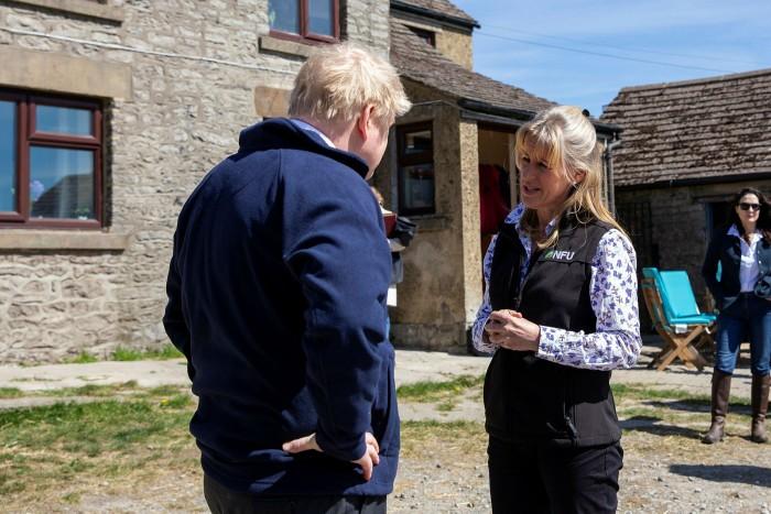 Premier Boris Johnson visits a farm with NFU President Minette Batters