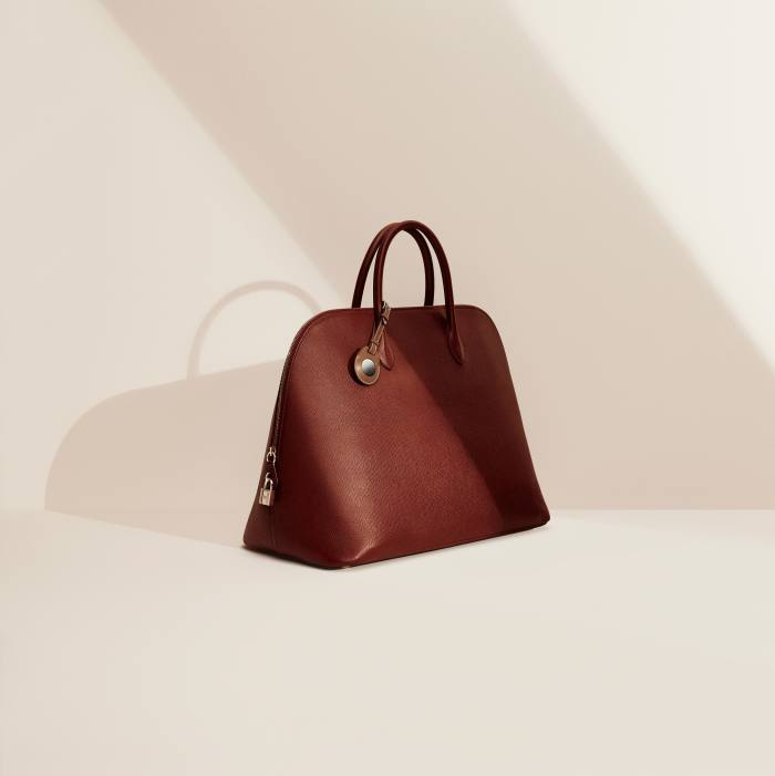 HermèsBolide travel bag in Volnyka calfskin, £11,460; with AirTag Hermèsleather luggage tag, £399