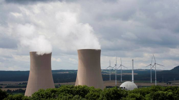 Steam rises from the cooling towers of the Grohnde nuclear power plant