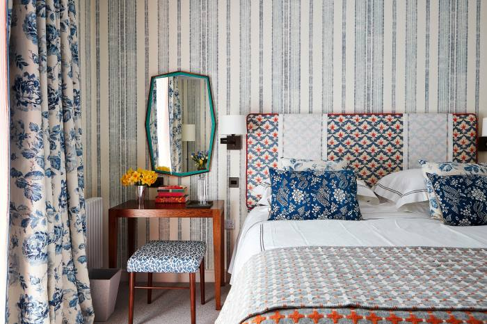 Wallpaper, curtain and headboard fabric by Richard Smith of Madeaux in Hastings. Bed cushions by Katherine Pole at the Decorative Antique Fair