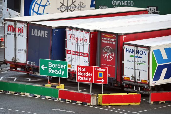 Signs at the port of Holyhead, Wales, reflecting the paperwork now required for lorries going to Ireland. HM Revenue & Customs puts the annual cost to business of filling in 215 million import and export forms at £7.5bn