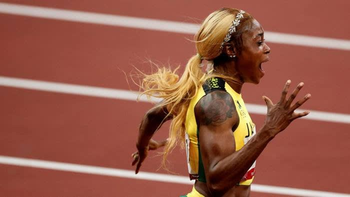 Jamaican Elaine Thompson-Herah celebrates after winning the women's 100m final at the 2020 Tokyo Olympics and setting a new Olympic record © AFP via Getty Images