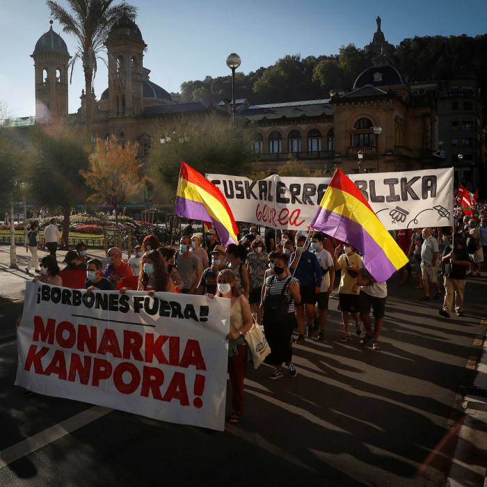 Protesters wave Spain's republican flag during a demonstration against the monarchy in San Sebastián on Wednesday