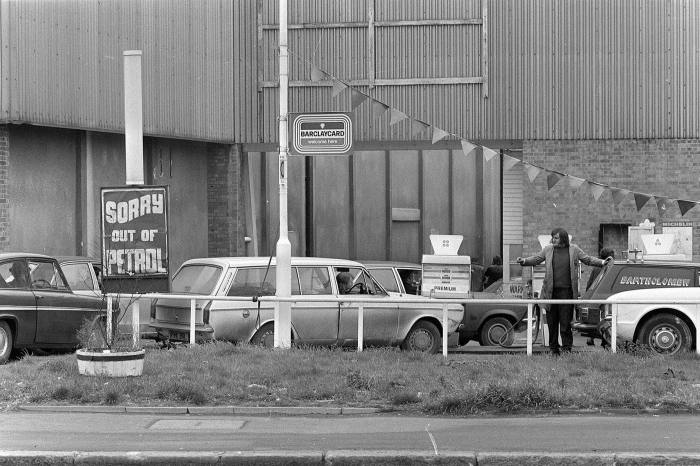 Motorists queue at a petrol station on Purley Way, Surrey, in December 1973