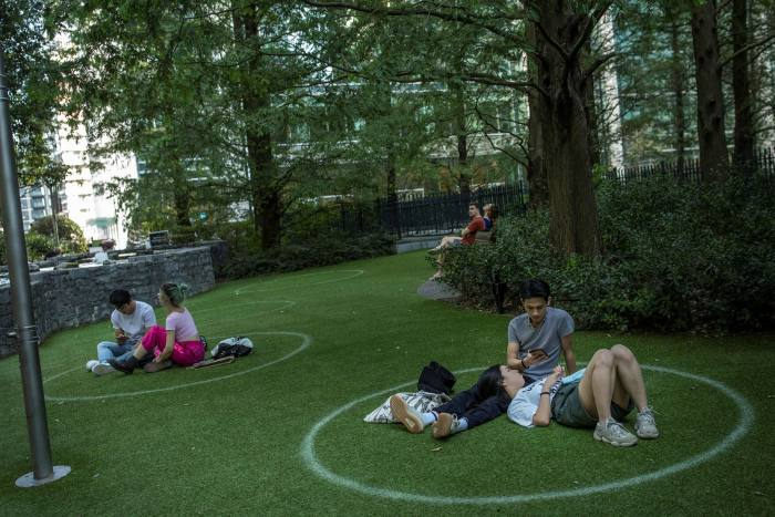 Social-distancing markers at a Canary Wharf green spot