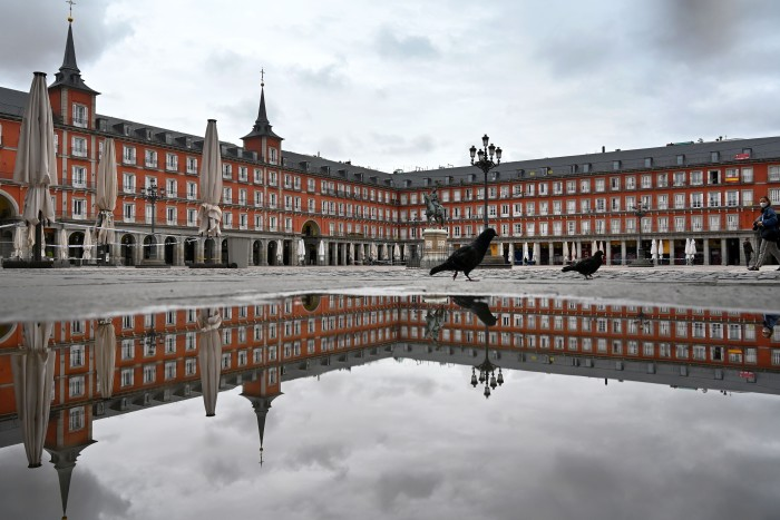 A deserted Plaza Mayor during lockdown in Madrid, April 21.  Spain's inability to chart the early spread of infection and consequent delays in locking down contributed to a tragic outcome