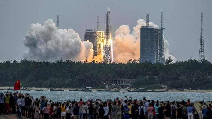 Crowds cheer as the Long March 5B rocket lifts off from the Wenchang launch site in China's Hainan province © AFP via Getty Images