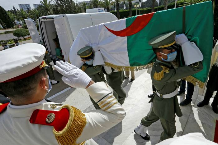 Coffins draped with national flags, containing the remains of 24 Algerian resistance fighters, at the Moufdi Zakaria palace, in Algiers, in July 2020