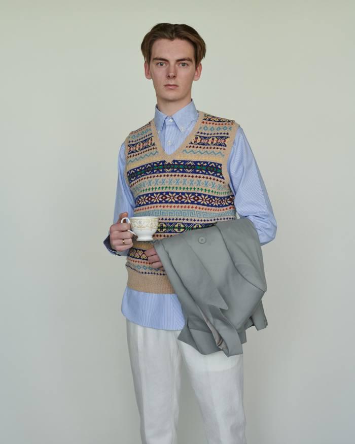 Scott wears Polo Ralph Lauren wool vest, £259, cotton Oxford shirt, £95, and linen/cotton trousers, £129. Ralph Lauren Purple Label wool jacket, £4,230 for suit