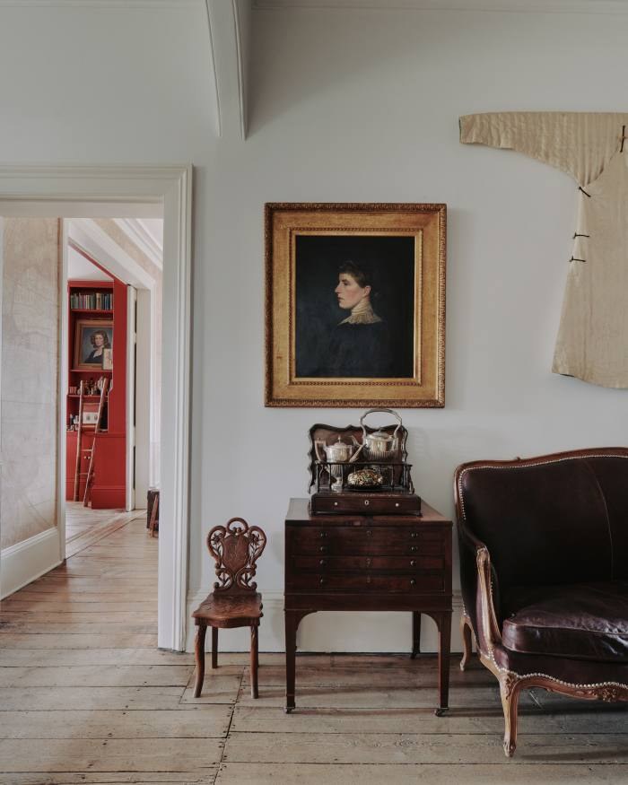 The front hall, where a portrait of an ancestor is juxtaposed with a 19th-century Chinese jacket