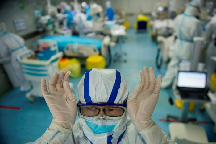 Staff at an intensive care unit treating Covid-19 patients at a hospital in Wuhan on February 22