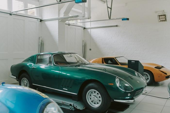 Berryman's 1960s Ferrari 275GTB and (behind) Lamborghini Miura P400