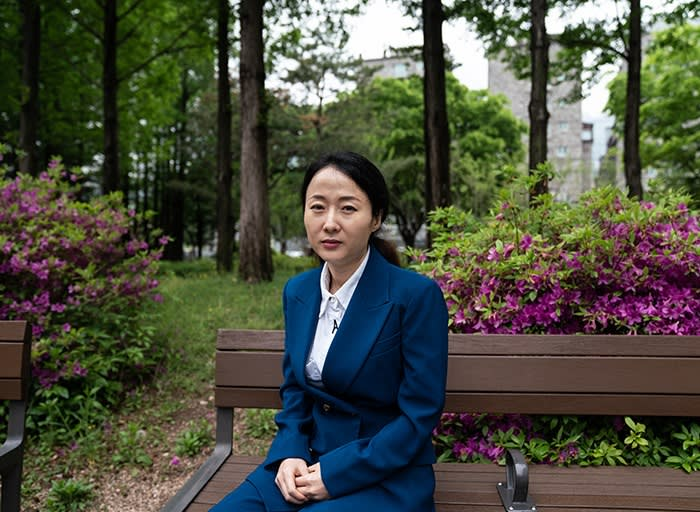 Lee Han-byeol in a park outside of her home