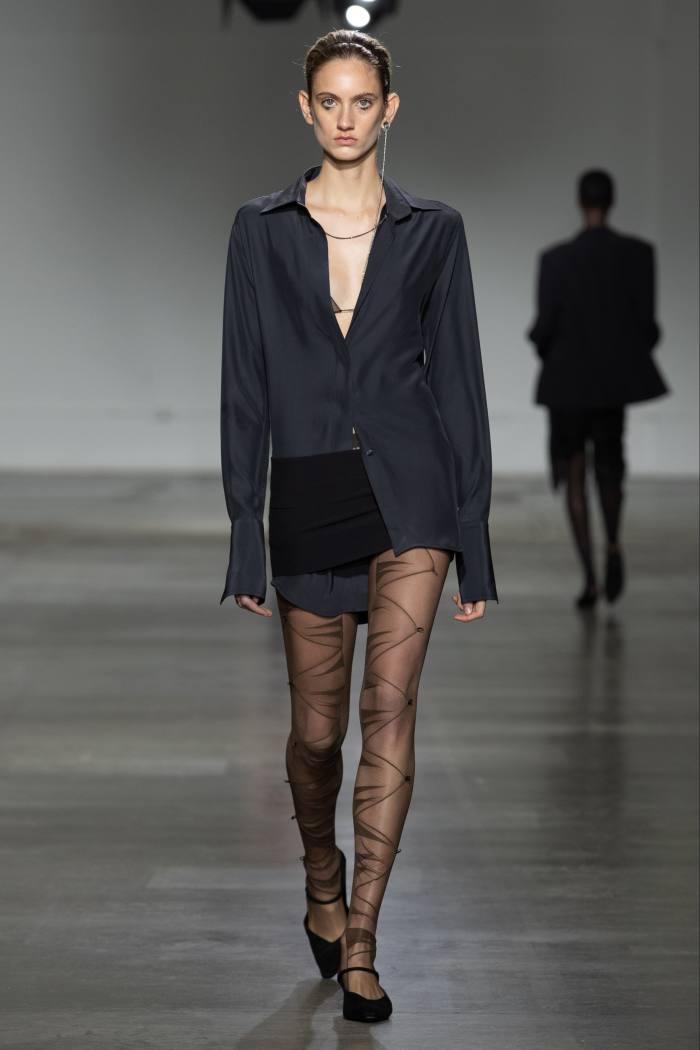 Nensi Dojaka silk oversized shirt, £635, viscose miniskirt, £420, and tulle leggings, £460, ssense.com