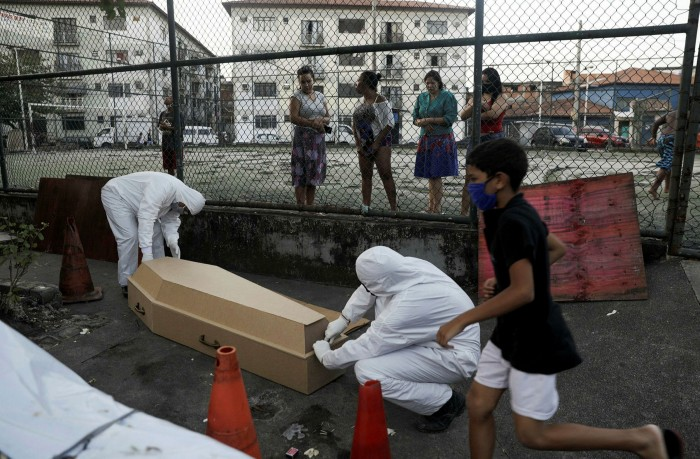 A body is removed from a Rio street. Public health expert Lígia Bahia says 'people aren't dying because of coronavirus variants or the severity of Covil-19 — they are dying because they do not have access to healthcare'