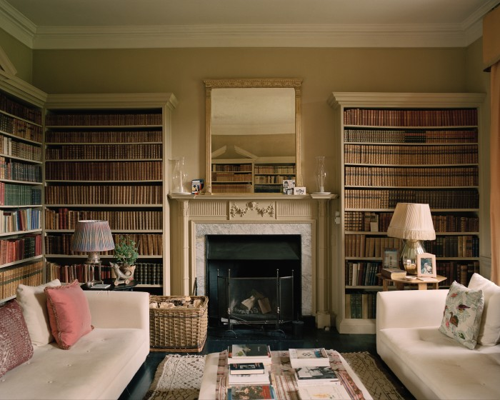 The library sofas and ottoman are from Caravane