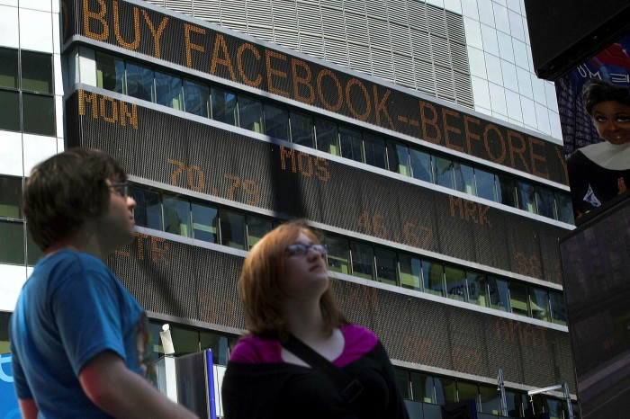 Facebook's initial public offer is displayed on a news ticker in New York in 2012. The IPO created a frenzied market where independent brokers facilitated thousands of trades with little oversight from the company