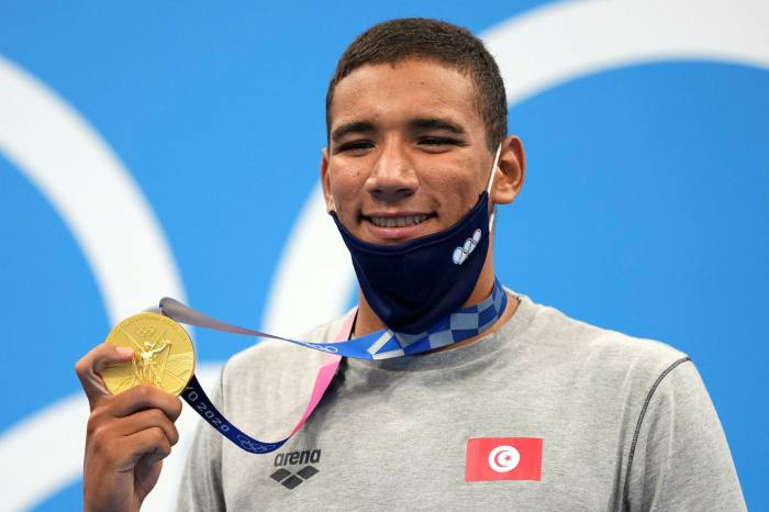 Ahmed Hafnaoui of Tunisia, poses with his gold medal after winning of the men's 400-metre freestyle