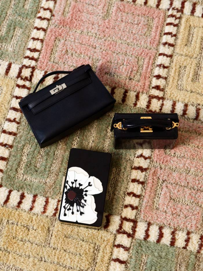 Kling's collection of clutches includes (from top) an Hermès Mini Kelly, a Mark Cross and a Valentino