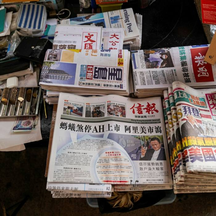 Copies of the Hong Kong Economic Journal show Jack Ma on the front page, at a newspaper stand in Hong Kong yesterday
