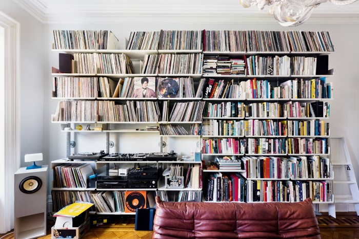 Vinyl, books and turntables in Adelman's living room