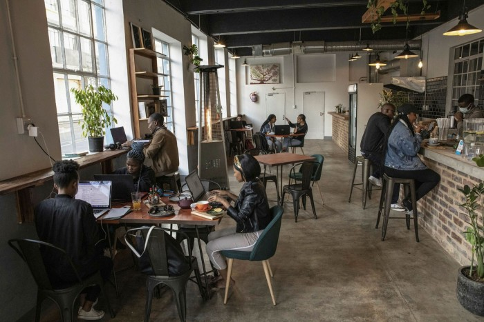 Customers work at laptops in a coffee shop in Johannesburg, South Africa, where the jobless rate for 15 to 25-year-olds is above 50 per cent