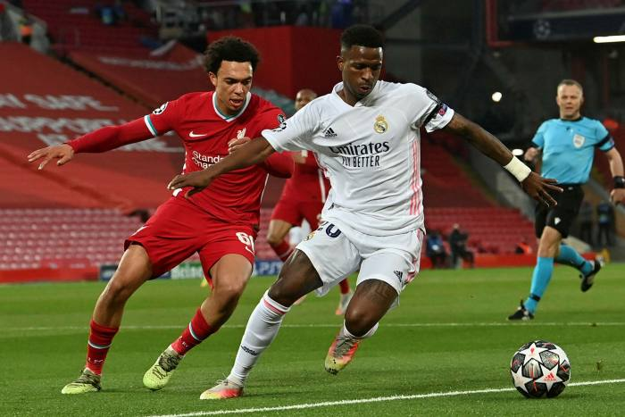 Liverpool's English defender Trent Alexander-Arnold (L) vies with Real Madrid's Brazilian forward Vinicius Junior during the UEFA Champions League quarter final