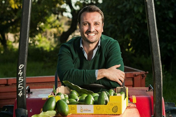 Andrea Passanisi with some of the avocados his grows at his farm in Sicily