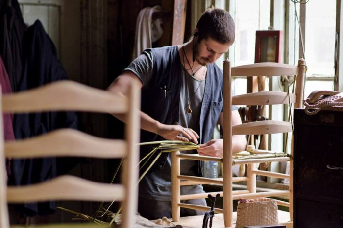 Artisan Sam Cooper making a rush seat at the Marchmont Workshop in the Scottish Borders