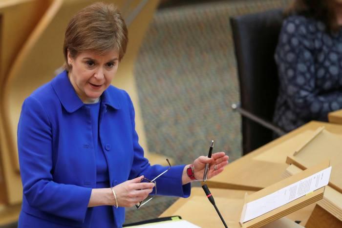 Nicola Sturgeon addresses the Scottish parliament in Edinburgh on Tuesday