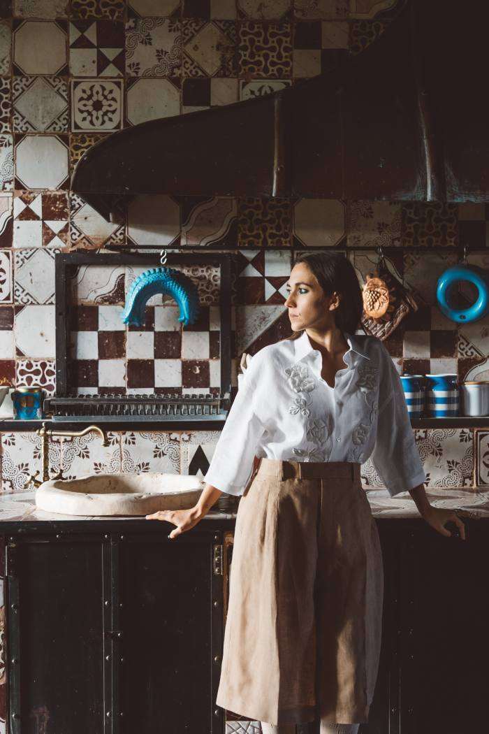 In the kitchen at I Casali del Pino. She wears Fendi embroidered linen shirt, POA, and linen trousers, POA, both from the spring/summer 2021 collection