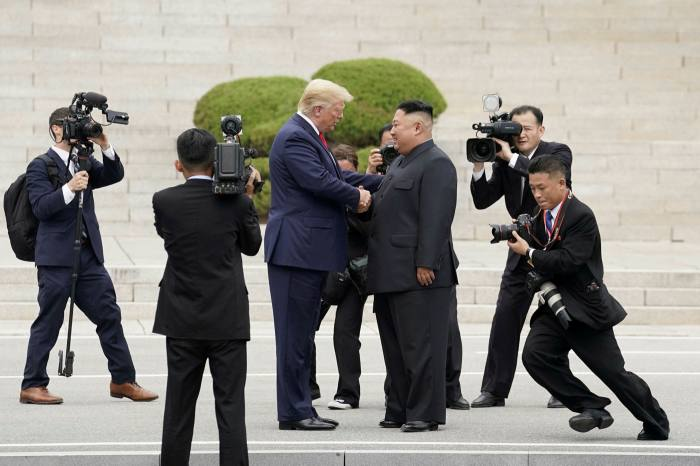 Kim Jong Un with then president Donald Trump at the demilitarised zone in Panmunjom, South Korea, in 2019