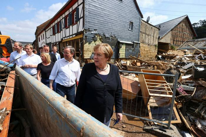 German Chancellor Angela Merkel and North Rhine-Westphalia's State Premier and CDU candidate for Chancellery Armin Laschet visit the flood-ravaged city of Iversheim in western Germany