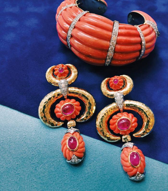 David Webb coral, diamond, gold and platinum fluted cuff, POA; and coral, diamond, cabochon ruby, gold and platinum crescent earrings, POA