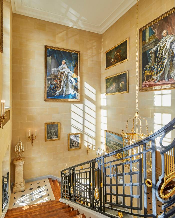 A staircase and artworks. The Airelles hotel group  used a surviving inventory from 1788 to restore the building to something like its old self