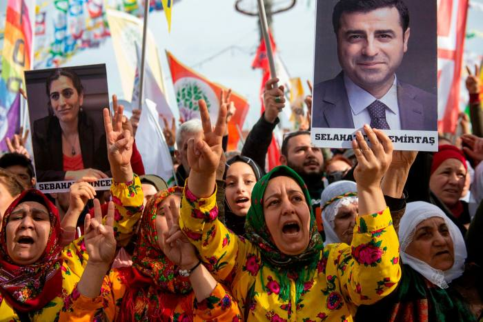Supporters of the HDP hold a picture of Mr Demirtas during a rally in Istanbul last year