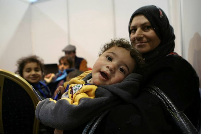 Syrian refugees wait to complete their migration procedures to Canada in 2015.