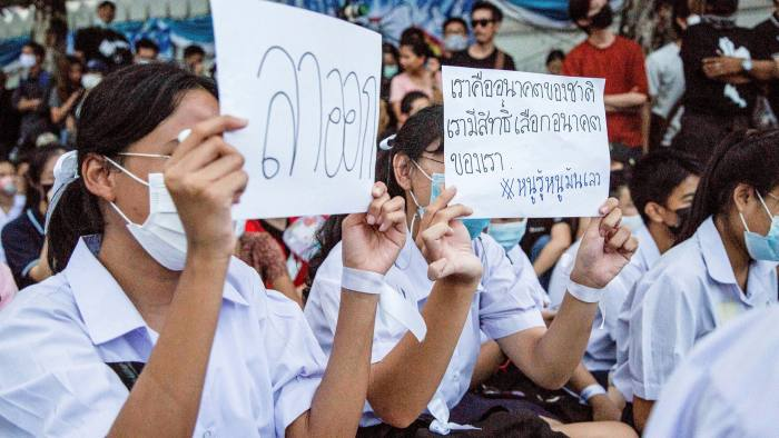 """High school students protest outside the Ministry of Education in September with placards reading """"Resign"""" and """"We are the future of the nation. We shall have rights to choose our future."""""""