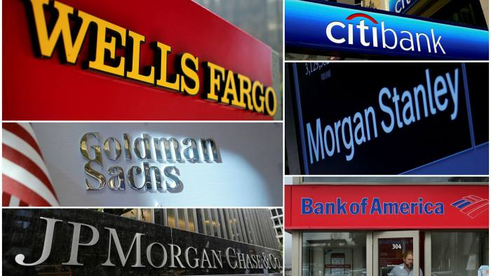 combination file photo shows signs for Wells Fargo, Citibank, Morgan Stanley, Bank of America, JPMorgan Chase and Goldman Sachs