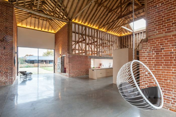 A bubble chair designed by Ben Rousseau in the Assington barn conversion by David Nossiter architects