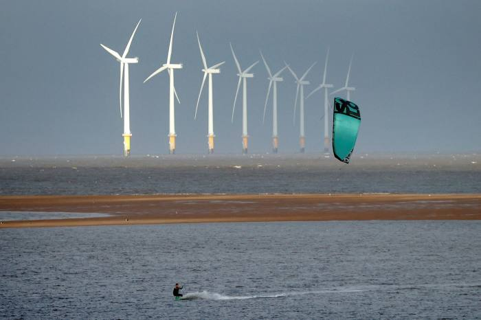 A kite surfer is pictured in front of the Burbo Bank offshore wind farm in Liverpool Bay on the west coast of the UK