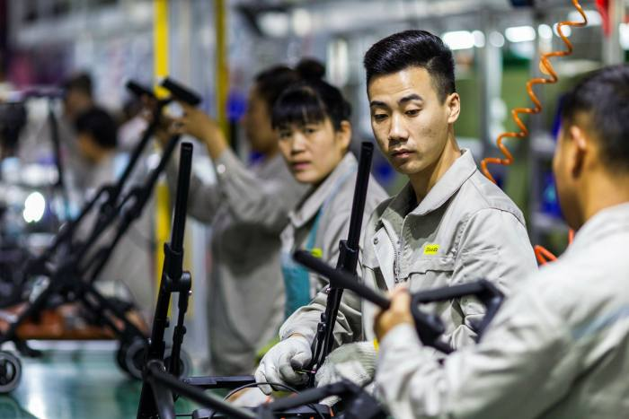 Strollers are assembled at a factory that makes equipment for babies and children in Kunshan city near Suzhou