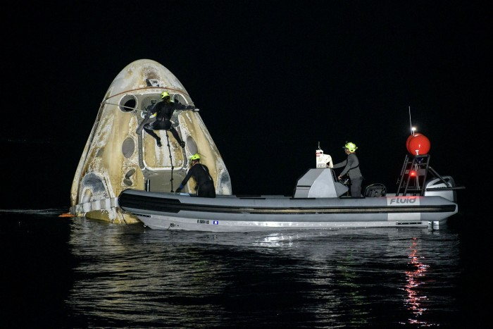 Support teams work around SpaceX's Crew Dragon Resilience spacecraft shortly after it landed in the Gulf of Mexico in May 2021